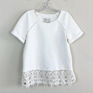 Anthropologie | crochet hem short sleeve top XS